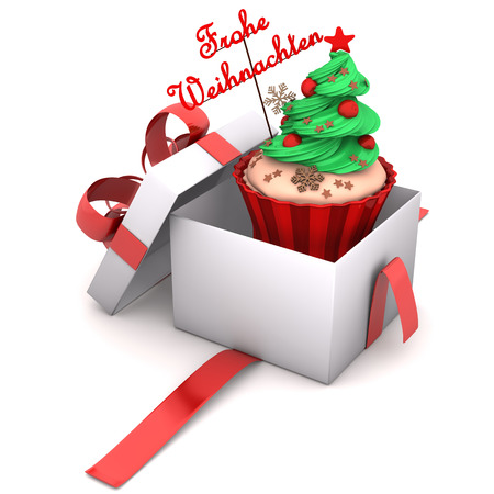 Openend Gift with cupcake and german text Frohe Weihnachten, translate Merry Christmas. photo
