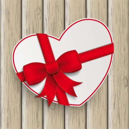 chit: White paper heart with red ribbon the wooden background.
