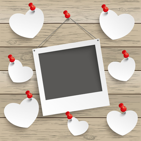 tacks: Paper photoframe and hearts with tacks on the wooden background. Eps 10 vector file. Illustration