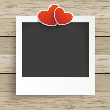 pic: Photo frame with 2 hearts on the wooden background. Eps 10 vector file.