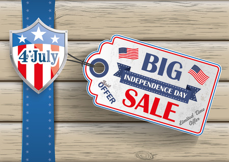 price sticker: 4th of july with price sticker on the wooden background.