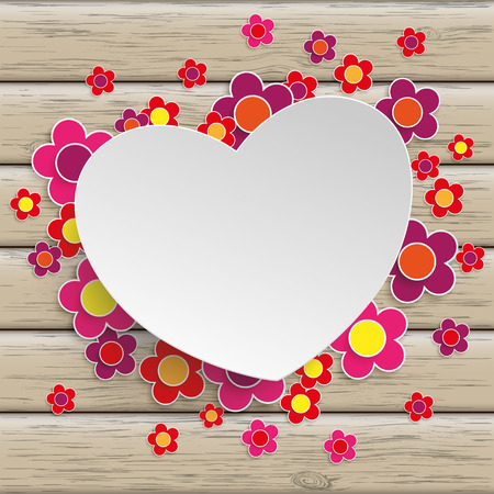 mothering: White paper heart with flowers on the wooden background.