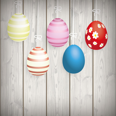 eps 10: 5 easter eggs on the wooden background. Eps 10 vector file.