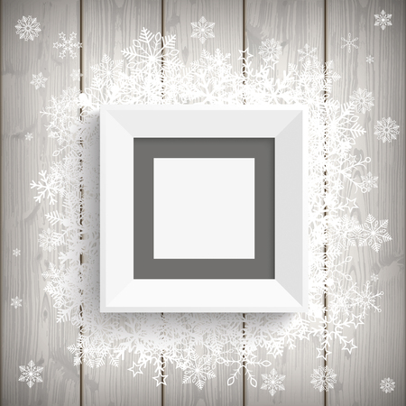 white picture frame: White picture frame with snowflakes on the wooden background.  Illustration