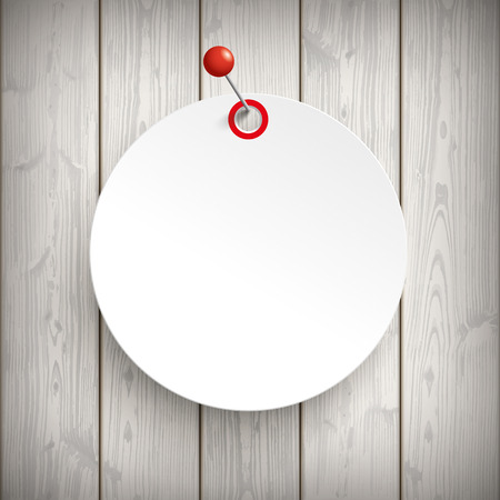 wooden circle: White paper circle sticker with red pin on the wooden background.   Illustration