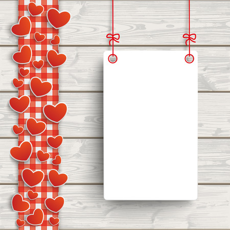 paper board: Red checked tablecloth with hearts and white paper board on the wooden background.