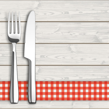 laths: Knife and fork with checked table cloth on the wooden background.