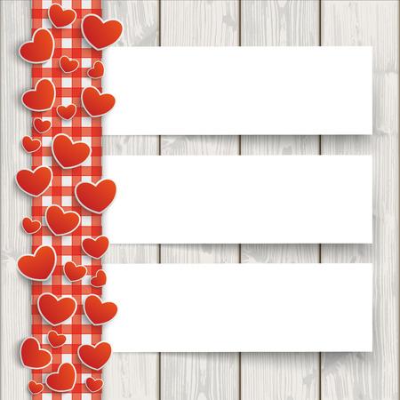 Mantel controlado rojo con corazones y banderas de papel blanco en el fondo de madera.