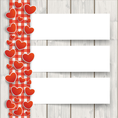 slats: Red checked tablecloth with hearts and white paper banners on the wooden background.