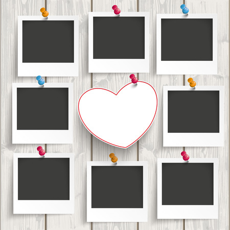mothersday: Instant photo frames with heart on the wooden background.