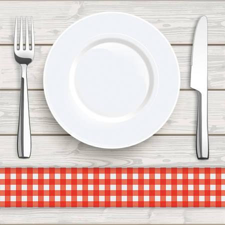checked: Knife, fork and plate with red checked table cloth on the wooden background.