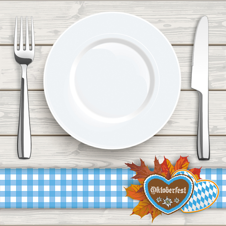 Flatware and gingerbread with text Oktoberfest on the wooden background.