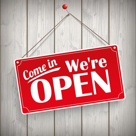 """Rode hangende bord met de tekst """"Kom binnen, we zijn open""""."""