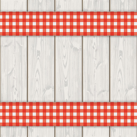 Red checked tablecloth on the wooden background.