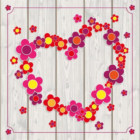 Fondo de madera con flores, en forma de corazón y marco de la vendimia.