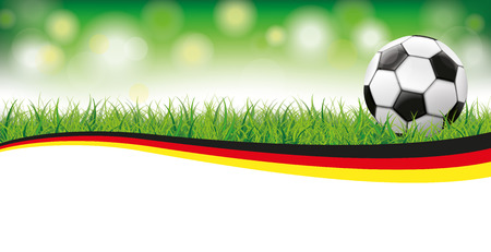 german flag: Classic football in grass with german flag on the bokeh background. 10 vector file.