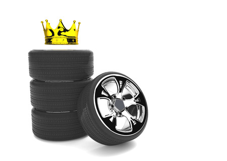 Chromed felly with tires and golden crown on the white. 3d illustration.
