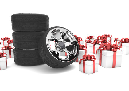 snow tire: Felly with tires and gifts on the white.