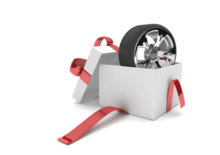 summer tires: Opened gift carton with felly and tire on the white. 3d illustration.