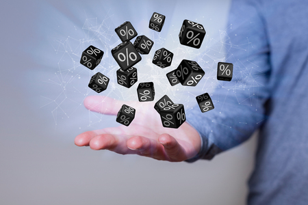 Man with black percent cubes over the hand.  Stock Photo