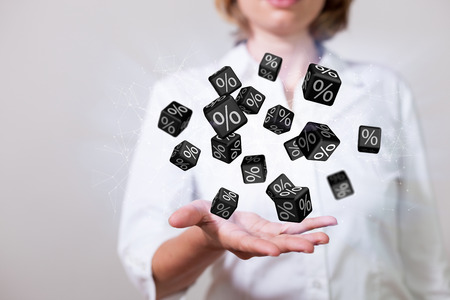 Woman with black discount cubes over the hand.
