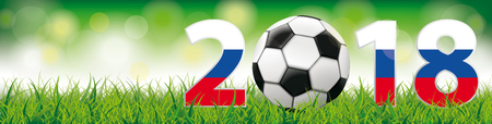 Classic football with Russian flag in grass on the bokeh background.
