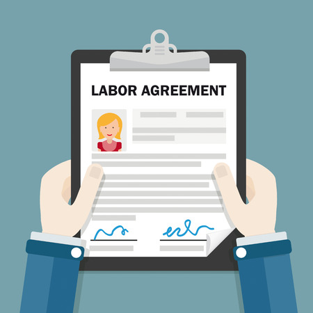 Hands with clipboard and text Labor Agreement.