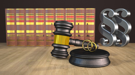 Judge gavel with wedding rings, books and paragraphs on the wooden table. 3d illustration.