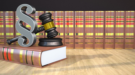 Judges gavel with paragraph and books on the wooden table. 3d illustration.