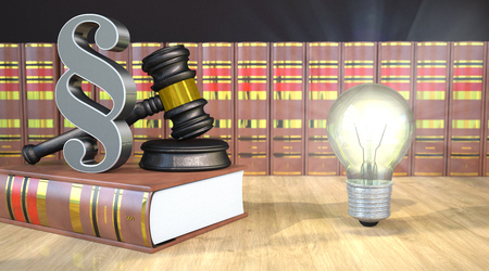 Paragraph with judges gavel, books and bulb on the wooden table.