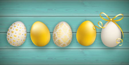 Easter eggs on the wooden background.
