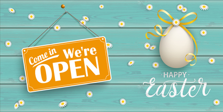 Easter egg with sign Come In We are Open on the wooden background.  Eps 10 vector file.