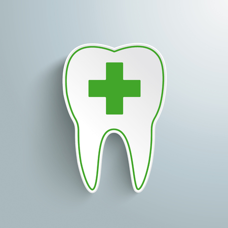 Green tooth with cross on the gray background.