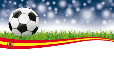 Classic football in grass with spanish flag on the bokeh background.