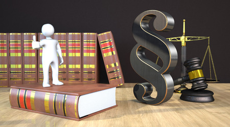 Manikin with paragraph on the wooden table with gavel, balance and law books. 3d illustration. 스톡 콘텐츠