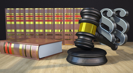Judges gavel with paragraph and books on the wooden table. 3d illustration. Stock Photo