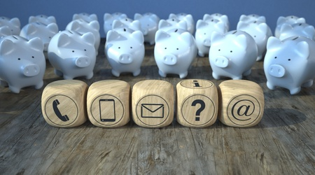 White piggy banks with wooden contact cubes on the wooden table. 3d illustration.