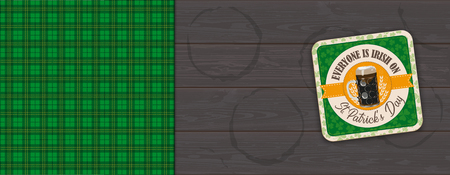 St Patricks Day beer coaster and green tartan on the dark wooden background.