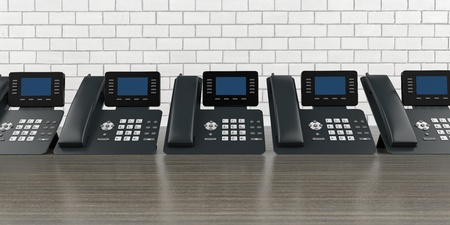 Business phones on the wooden table. 3d illustration.