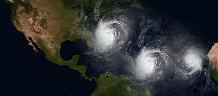 Extremely detailed and realistic high resolution 3d illustration of 3 hurricanes approaching Northeastern USA. Shot from space. Elements of this image are furnished by Nasa. Stock Photo