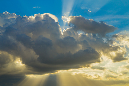 shining through: Rays of light shining through clouds Stock Photo