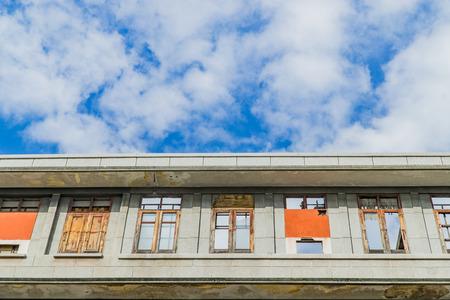 abandoned building: Old abandoned building under blue sky