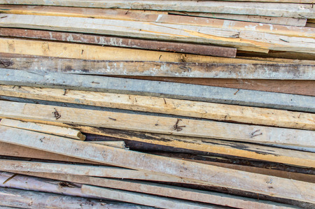 untidily: Pile of wood with nails facing up, very dangerous