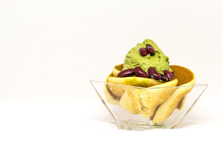 enrich: green tea icecream enrich with pancake in glass cup on isolate white backgroud
