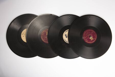MOSCOW / RUSSIA - 04/05/2020 isolated flat lay shot of a row of a stack of four old Soviet phonograph vinyls on a white background