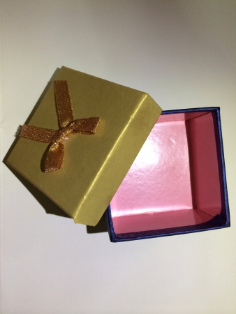 Opened golden blue gift box with pink interior Stock Photo