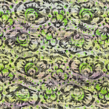 Seamless distressed mottled tie dye floral texture background.Distressed boho blur washed pattern. Blotched aged lime yellow purple cloth effect. Ragged old mash up flower collage all over print.
