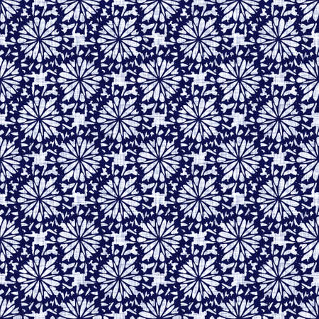 Indigo blue flower block print dyed linen texture background. Seamless woven japanese repeat batik pattern swatch. Floral organic distressed blur block print all over textile.