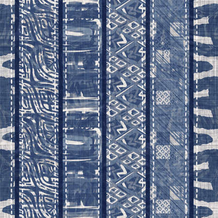 Denim blue patchwork stripe woven texture. Washed out vintage printed cotton textile effect. Patched jean home decor soft furnishing background. Scandi quilt stitch all over fabric print material. 免版税图像