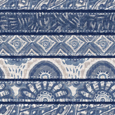 Denim blue patchwork stripe woven texture. Washed out vintage printed cotton textile effect. Patched jean home decor soft furnishing background. Scandi quilt stitch all over fabric print material. Archivio Fotografico